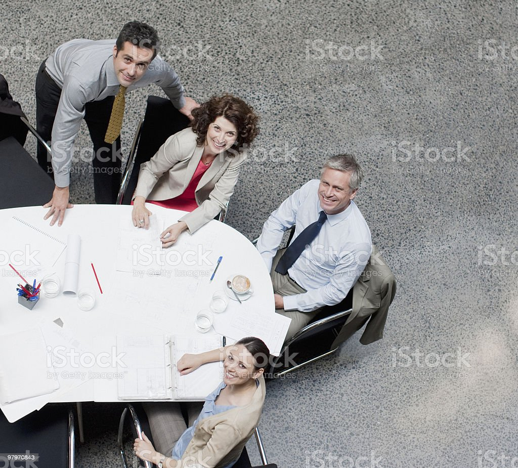 Directly above business people meeting at conference table royalty-free stock photo