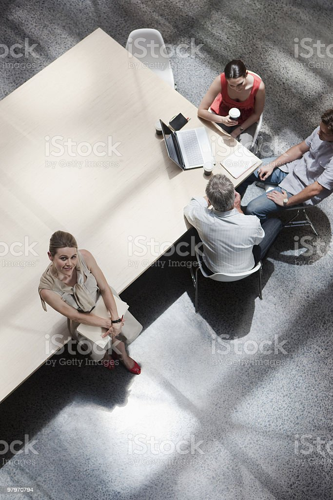 Directly above business people meeting in conference room royalty-free stock photo