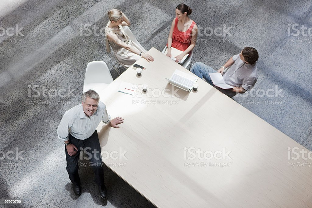 Directly above businessman with co-workers meeting at conference table royalty-free stock photo