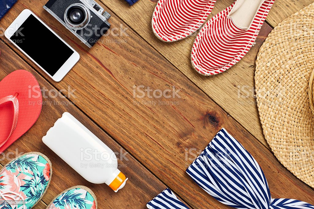 Directly above flat lay of travel and beach accessories stock photo