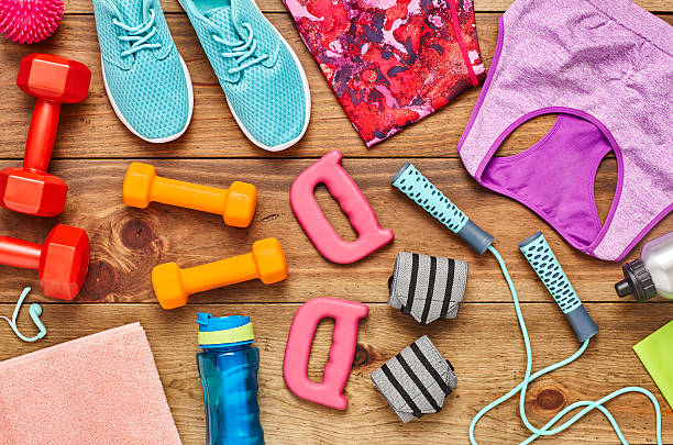 Directly above flat lay shot of various sports equipment - foto de stock