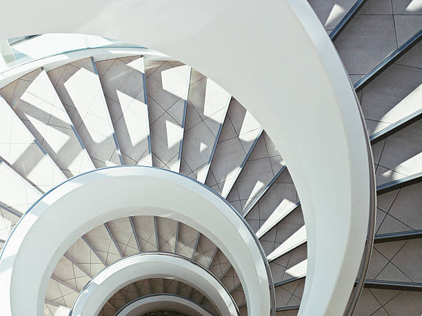Directly above modern, spiral staircase stock photo