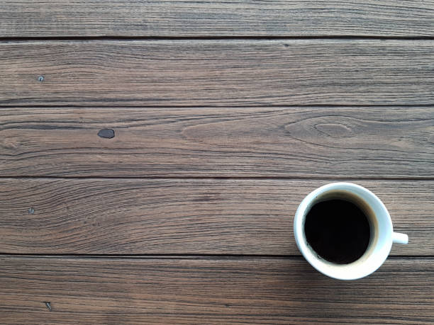 directly above shot of black coffee with copy space on wooden table - coffee table imagens e fotografias de stock