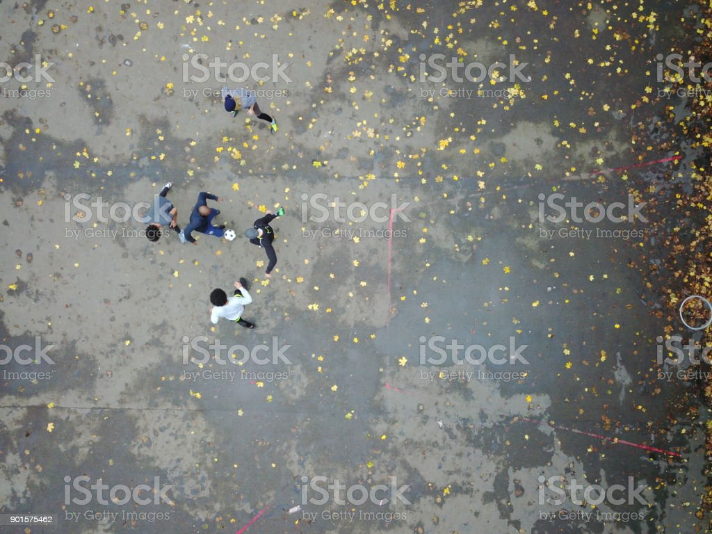 Directly above shot of player dribbling ball stock photo