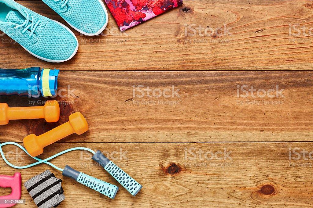 Directly above shot of sports equipment on hardwood floor stock photo