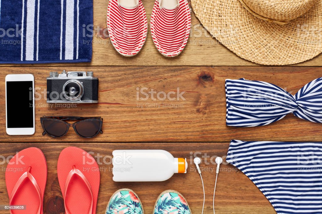 Directly above shot of travel and beach accessories flat lay stock photo