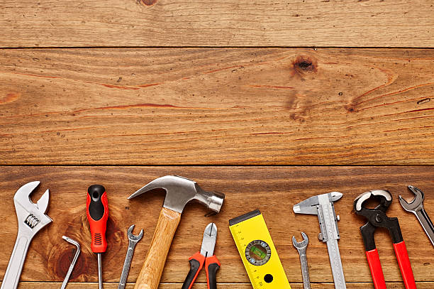 Directly above shot of various carpentry tools on wooden floor – Foto