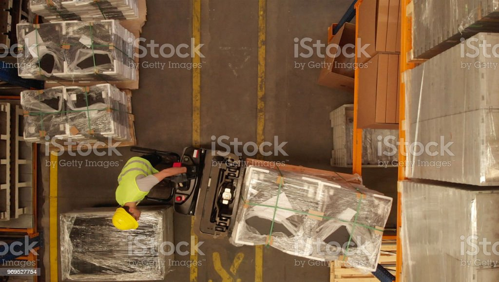 Directly Above View of a Forklift in a Warehouse of a Factory stock photo