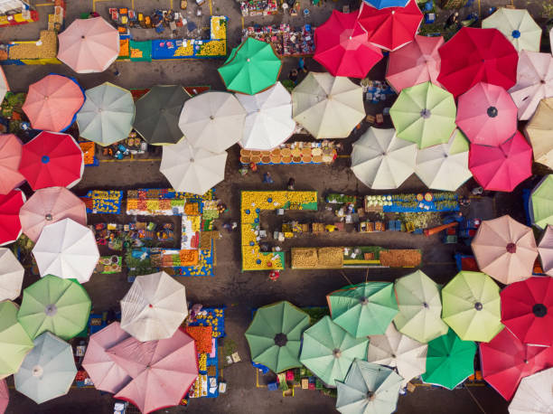Directly Above View of a Neighborhood Market in Turkey Sunshades and market stalls in a local market. turkey middle east stock pictures, royalty-free photos & images