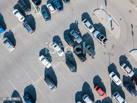istock directly above view of cars abstract parked on the asphalt lot 1014578824