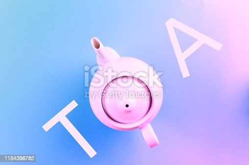 Directly above view of teapot on blue background