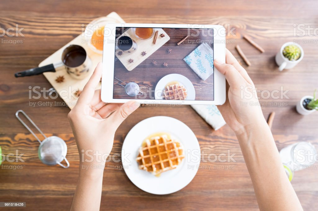 Photographing cooking composition on tablet