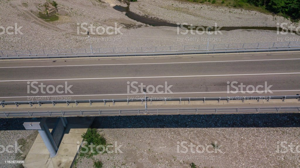 Aerial top view drone shot of bridge with cars on bridge road image...