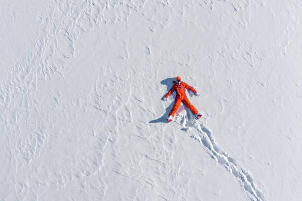 Directly above view woman in ski clothes lying in snow picture id1125287462?b=1&k=6&m=1125287462&s=612x612&w=0&h=y9fiio3tw33ij36muvivtpfz30wxufhssfvkprvyem4=