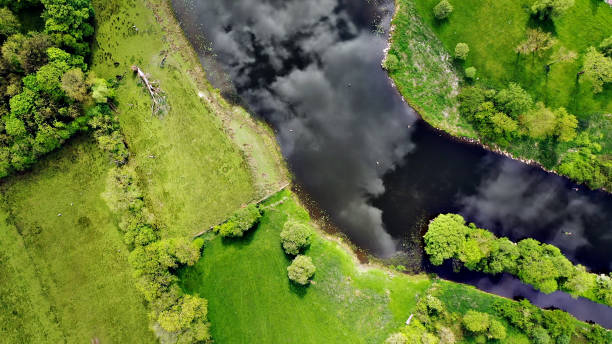 Directly above views of fields with river Erne in Ireland stock photo