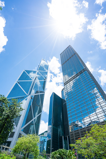 istock Directly below of modern financial skyscrapers in central Hong Kong 1180310709