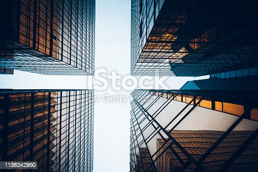 directly below view of golden glass curtain wall against sky,Hong Kong,China.