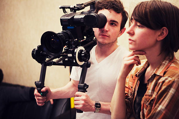 director and dp consider a shot - film director stock pictures, royalty-free photos & images