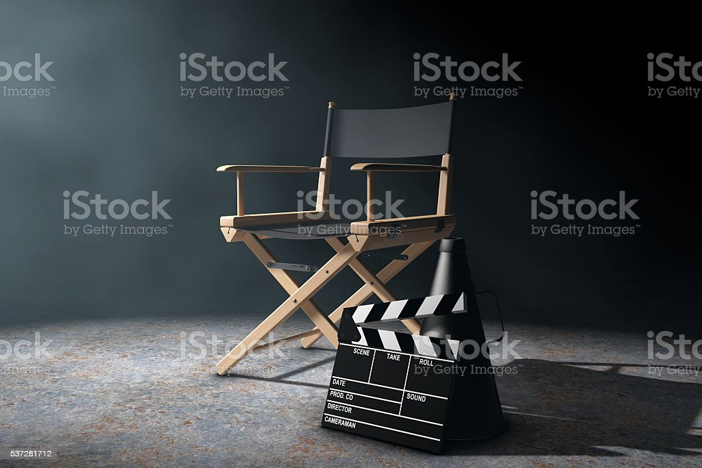 Director Chair, Movie Clapper and Megaphone in the volumetric li stock photo