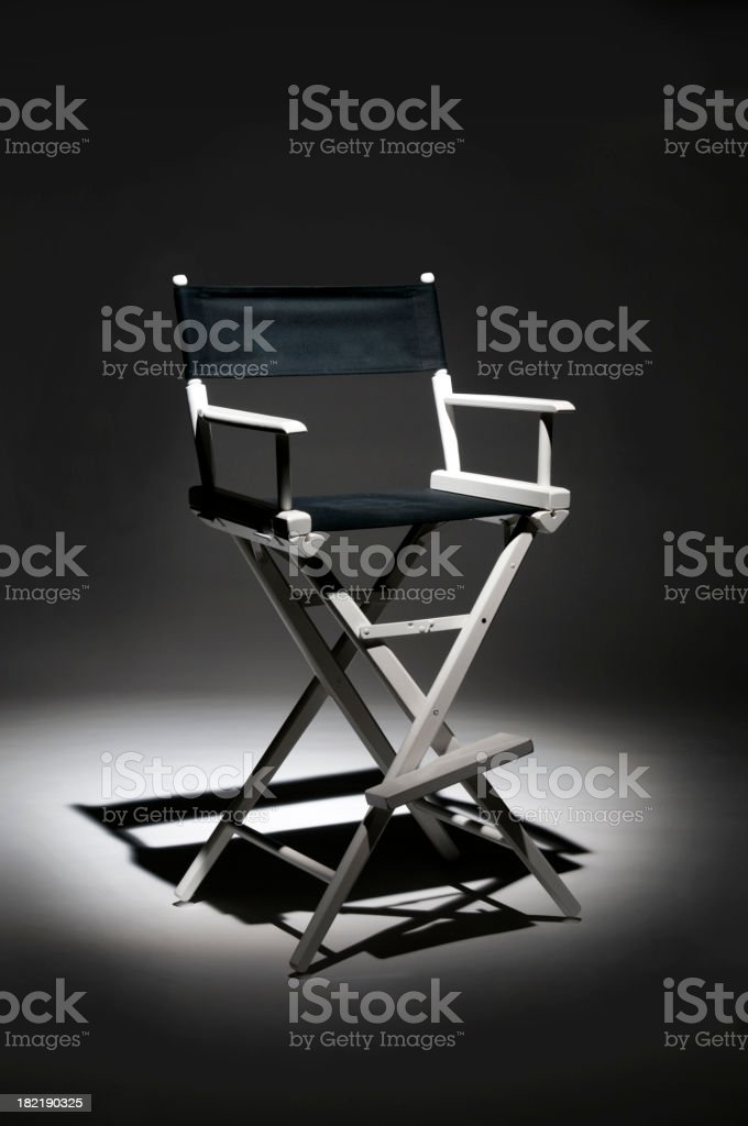 Director chair with spotlight on it stock photo