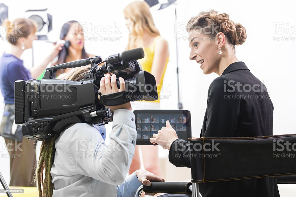 Director giving cameraman direction for video production stock photo