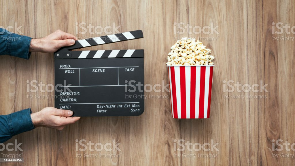 Director holding a clapper board stock photo