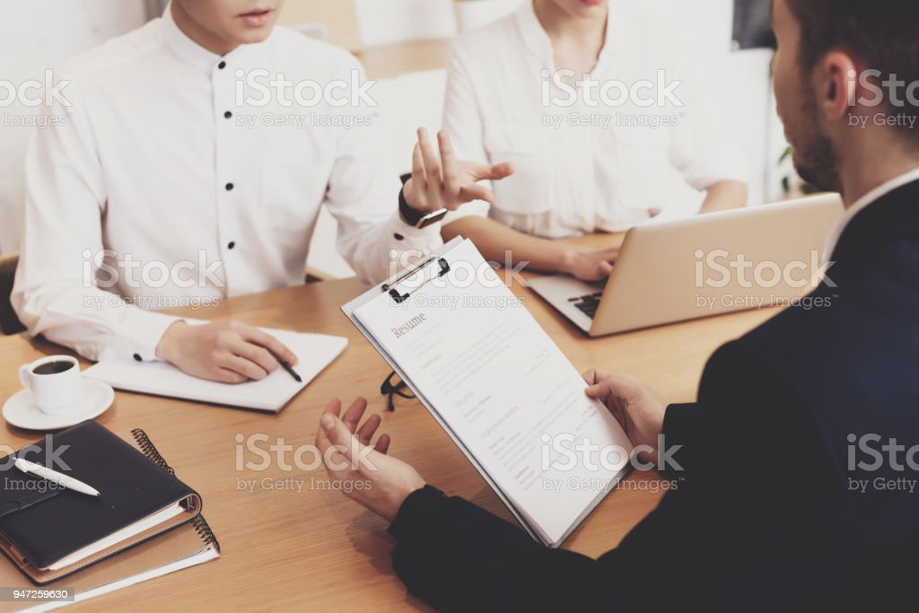 HR director woman is working in office. Pepole discussing resume at job interview. stock photo