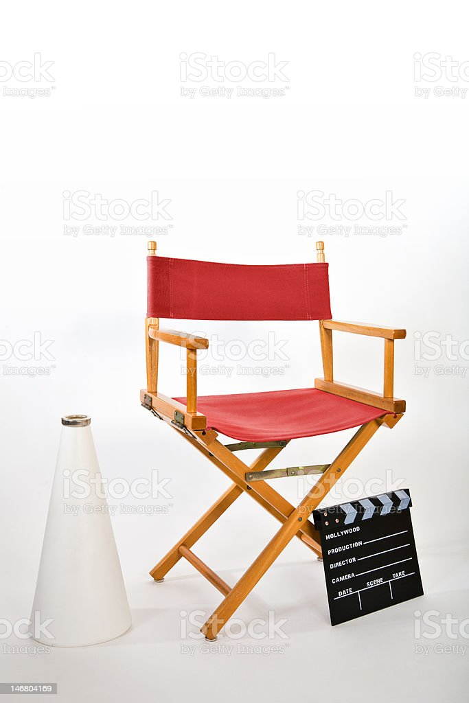 A movie director\'s chair, megaphone and clapboard.
