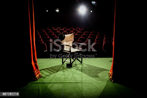 istock Director's chair on stage 887282216