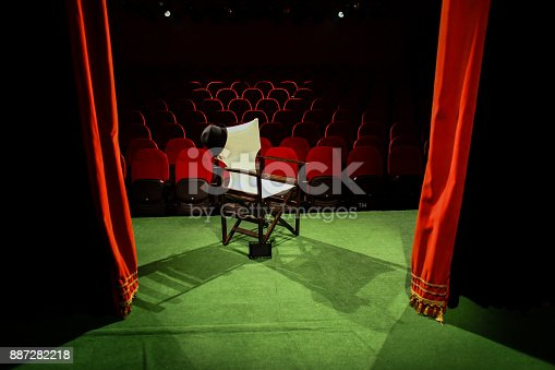 istock Director's chair on stage 887282218