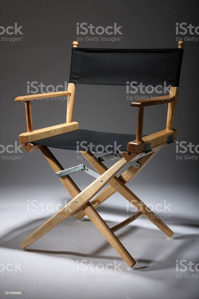 Director\'s Chair in contrast lighting and shadow.