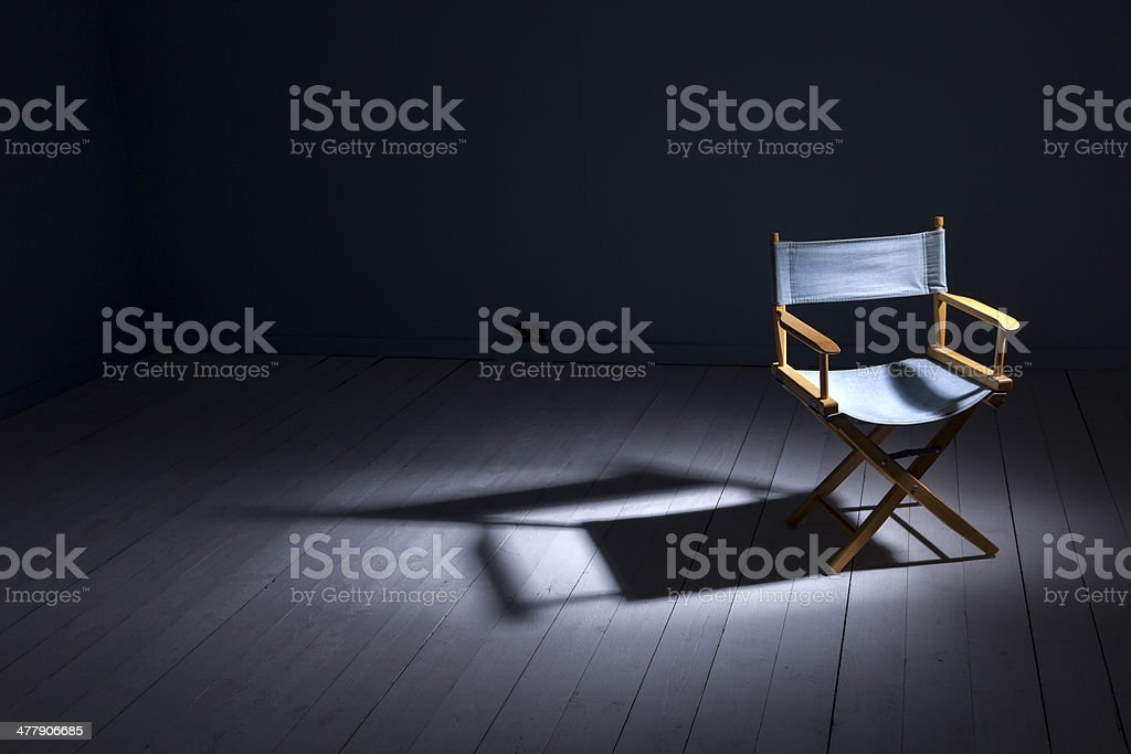 An empty Director\'s Chair in a bare room - waiting for the right...