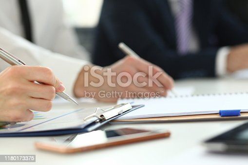 Focus on hand of chief executive officer. Business assembly of board of shareholders. Stockholders discussing stipulation of contract and closing bargain. Biz meeting concept