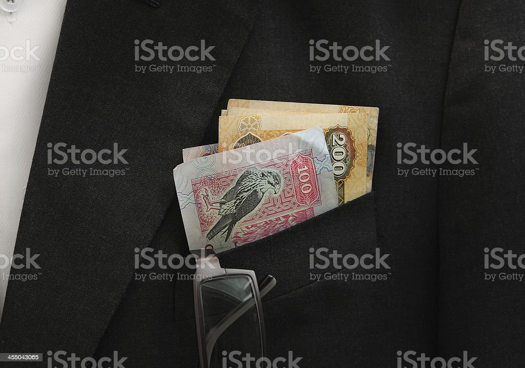 UAE Dirhams banknote on the pocket royalty-free stock photo