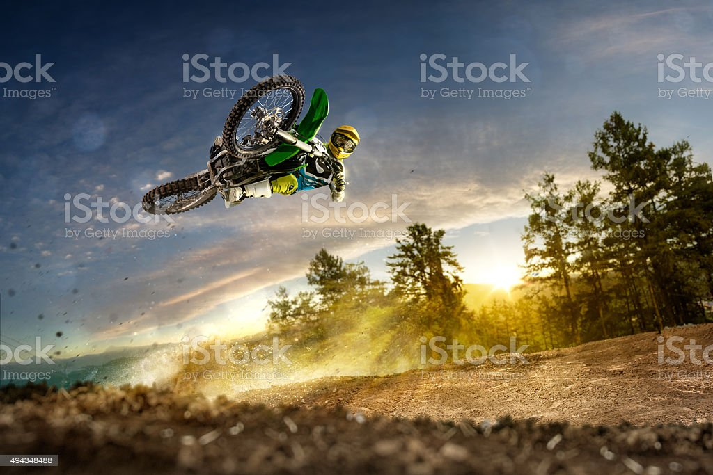 Dirt bike rider is flying high stock photo