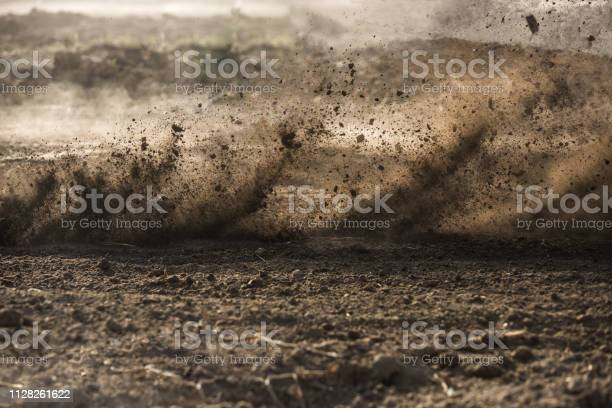 Photo of dirt fly after motocross roaring by