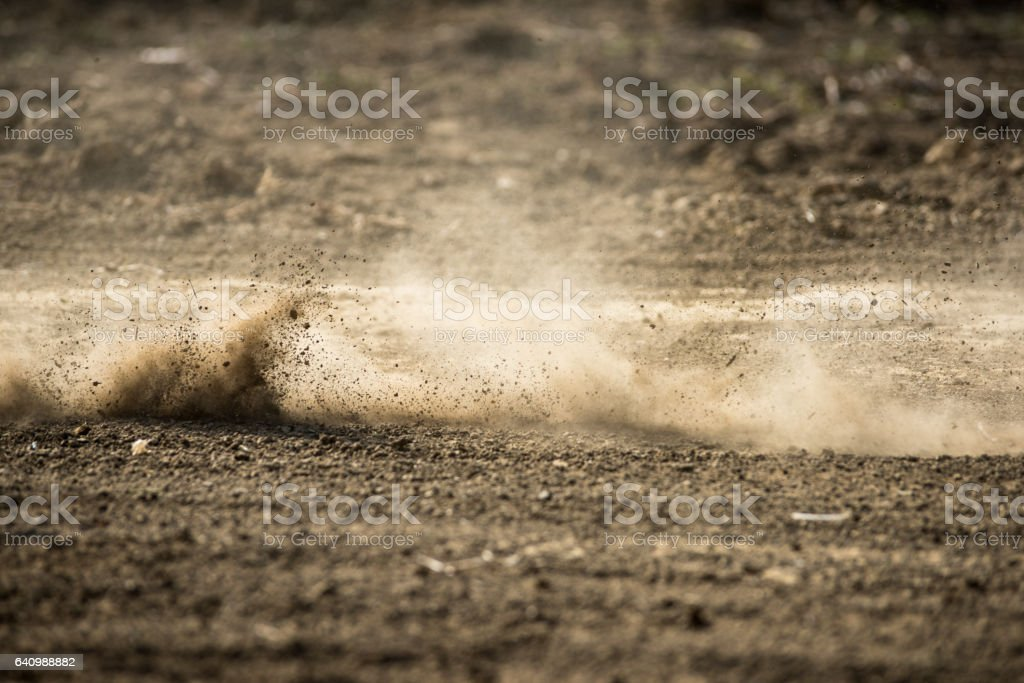 dirt fly after motocross roaring by stock photo