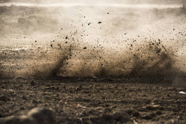 dirt fly after motocross roaring by - rough stock photos and pictures