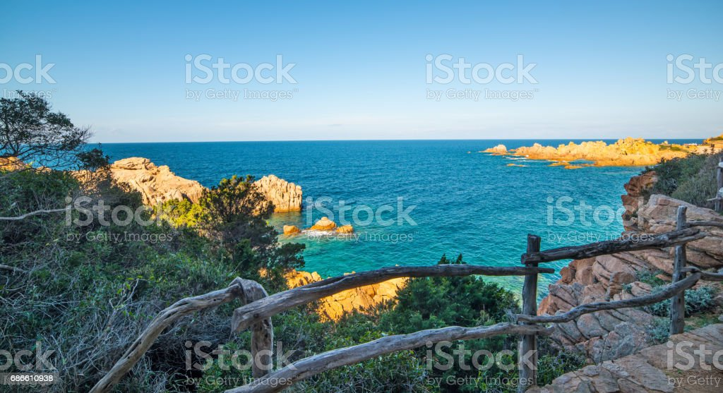 Dirt path and blue sea royalty-free stock photo