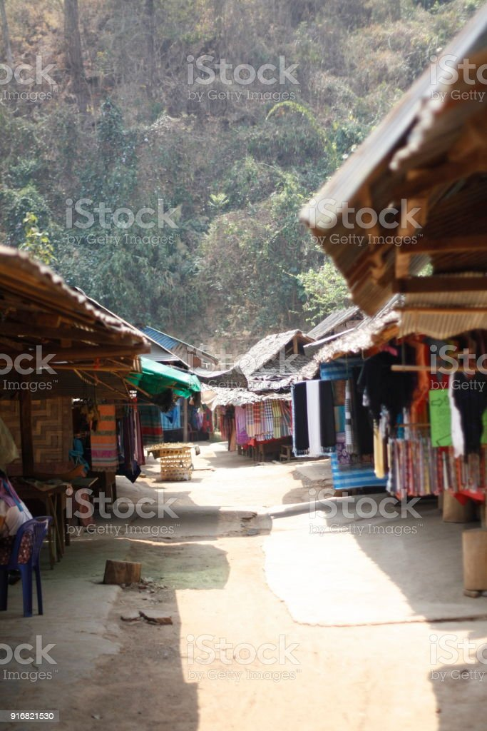 dirt path leading thru Market stalls at a local village in Northern Thailand selling woven and locally made goods stock photo