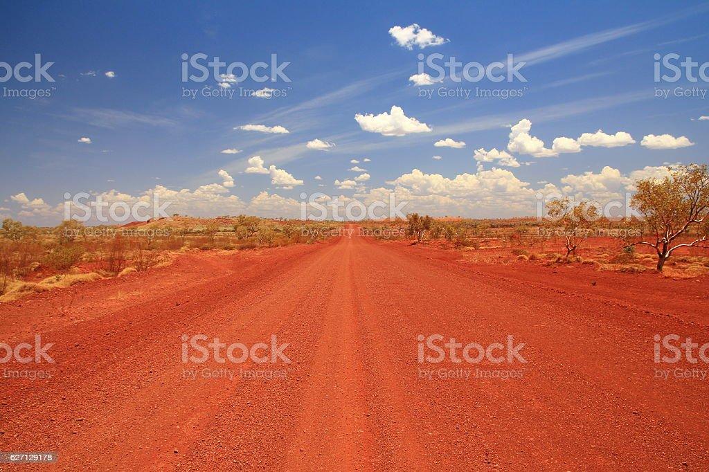 Dirt road across the Pilbara in Australian outback stock photo