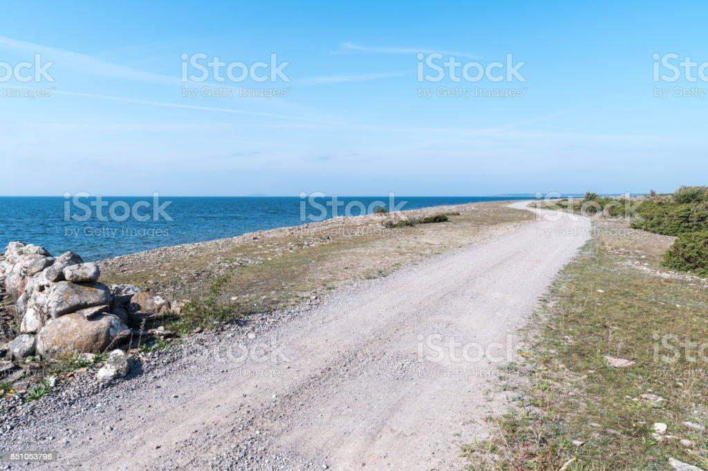 Dirt road along the coast stock photo