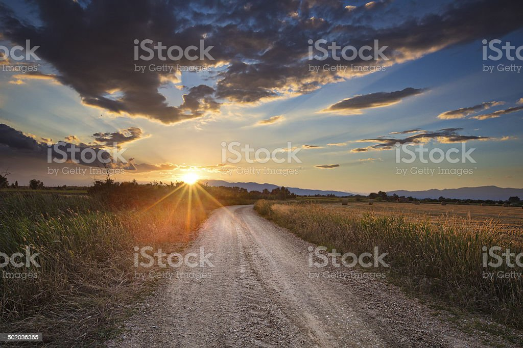 Dirt road at dusk stock photo