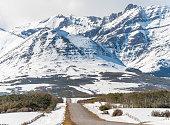 dirt road go through Canadian Rockies in winter