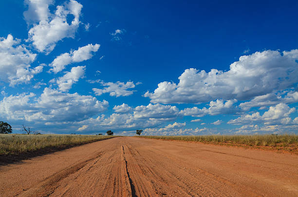 Dirt road in Australian rural outback tire print red soil stock photo