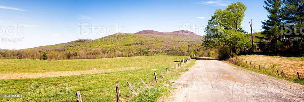 Dirt road leading to Vermont Appalachians mountain at Springtime stock photo