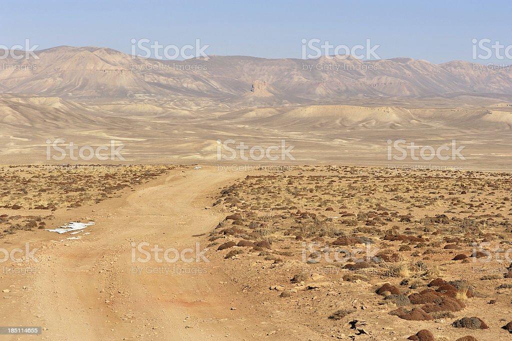 Dirt road through desert, Afghanistan stock photo