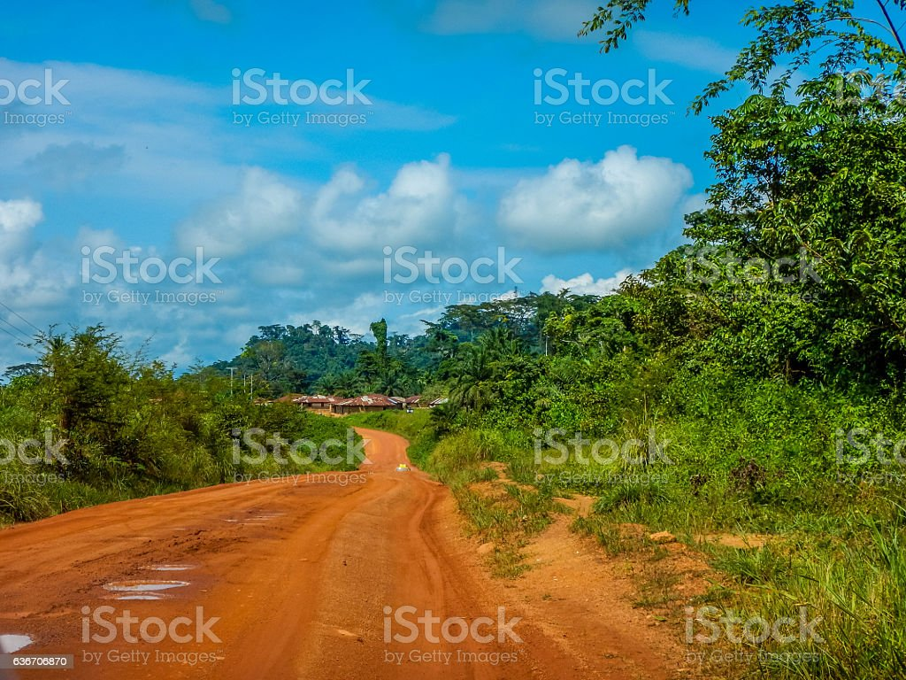 Dirt road through the jungle in Africa. Liberia stock photo