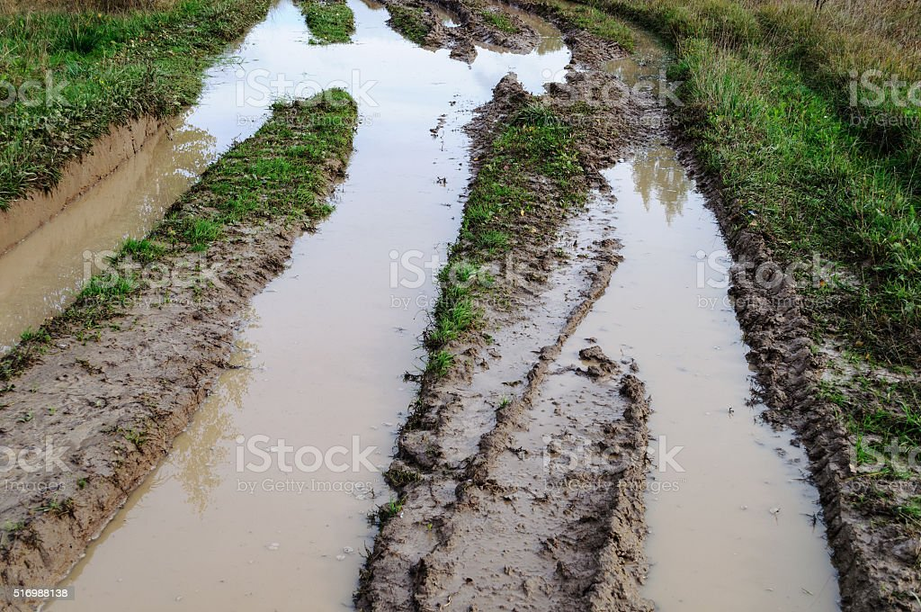 Dirt road with big puddles stock photo