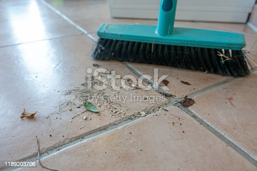 473158422 istock photo dirt swept with a broom is lying on the floor 1189203706